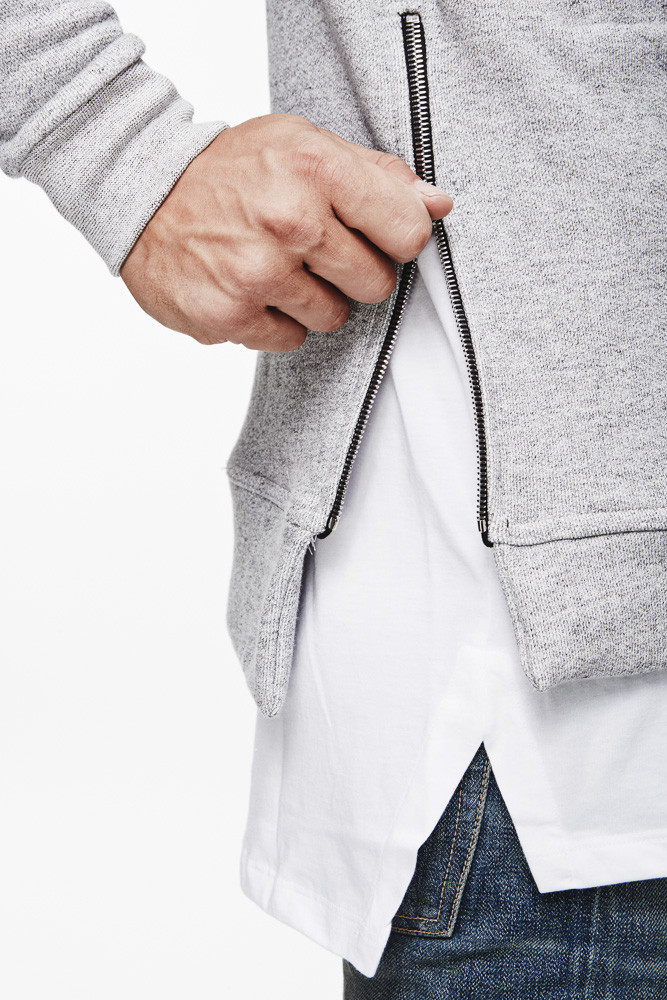 John Elliott + Co has used their own unique approach to everyday basics to freshen up the classic grey hoodie